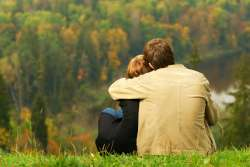 sweet-couple-sitting-on-a-hill-250.jpg